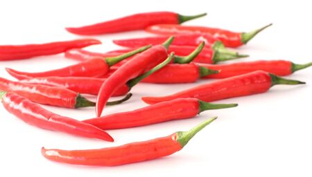 A heap red chillies on white background Stock Photo