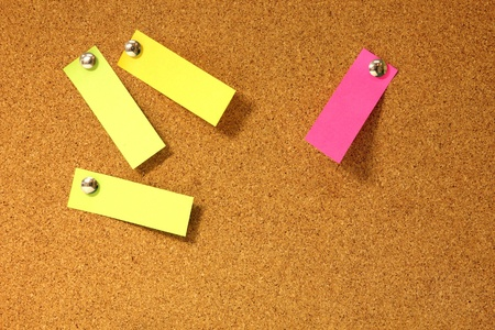 Post-it notes pushpins on cork board Stock Photo - 16559466