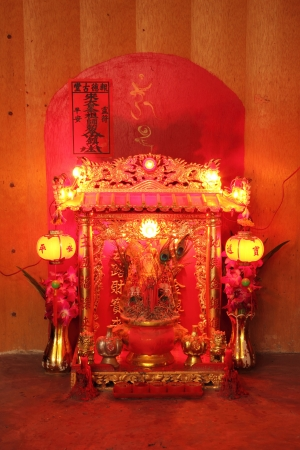 Small red traditional chinese shrine  photo