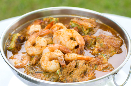 crab pots: Acacia Leave Omelet and Shrimps in Spicy Tamarind Flavored Soup, Thai Traditional Food. Stock Photo