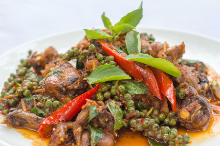 Stir fry frogs with chili paste and spicy, Thai traditional food.