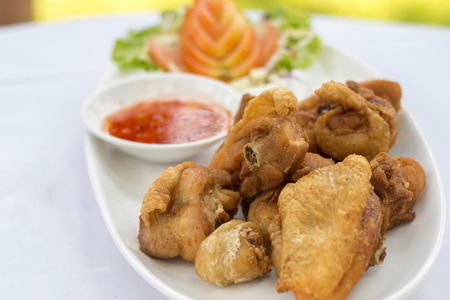 Deep fried chicken with sea salt and spicy sauce, Thai food. Stock Photo