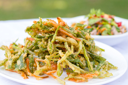 Crispy morning glory spicy salad, yum, Thai traditional food.