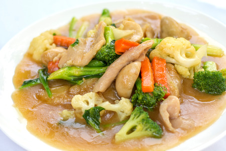 Fried noodles topped with pork in creamy gravy, Thai traditional food.