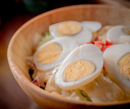 Delicious salad with egg and herbs, healthy food.