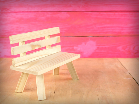 Wooden chair with pink background, template for design.