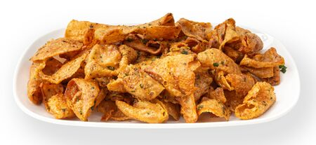 Crispy chicken skin on a white plate, snacks and Thai food