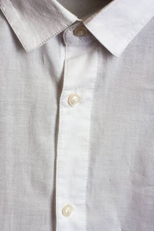 dinner wear: White shirt close up. Collar and buttons Stock Photo