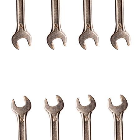 work related: Wrench chrome metallic spanners instrument isolated composition over white background