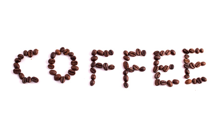 arabic coffee: Text made of coffee beans: COFFEE. Texture of the coffee beans on a white background. Smelly, saturated brown arabic coffee beans