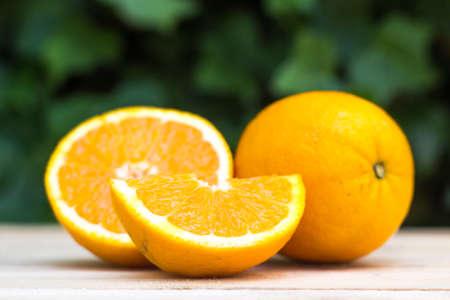 keywords background: Fresh ripe orange on wooden background. Exotic juicy mellow fruit Stock Photo