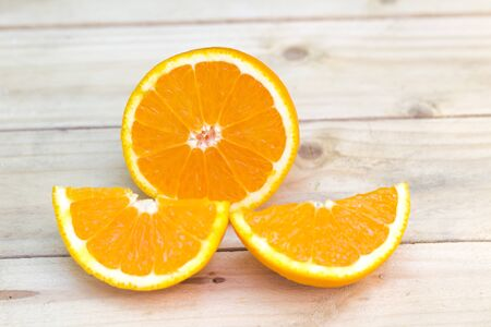 mellow: Fresh ripe oranges cut in a half on wooden background. Exotic juicy mellow fruit Stock Photo
