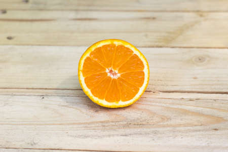 mellow: Fresh ripe orange on wooden background. Exotic juicy mellow fruit Stock Photo