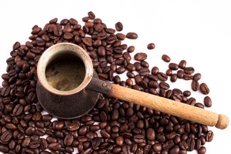 arabic coffee: Many coffee beans in the background. Texture of the coffee beans on a white background. Smelly, saturated brown arabic coffee beans Stock Photo