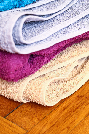 absorb: Colorful towels on wooden floor