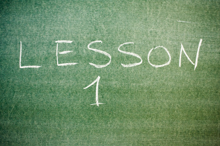 favorite number: Handwritten message on a chalkboard: lesson 1