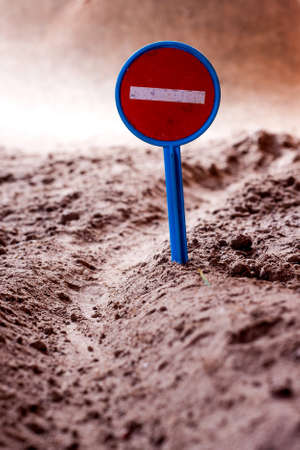 denial: Prohibition sign on a ground road