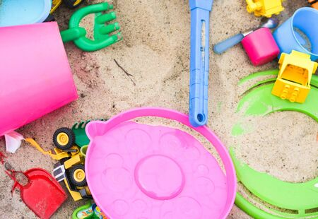 Colorful toys in the sandbox. Happy childhood, way to spend time. Stock Photo