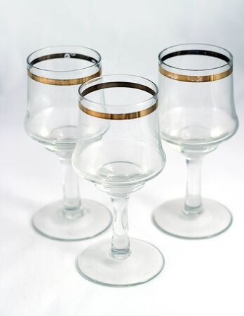 whine: Glasses for whine, vodka or other alcohol with gold ornament