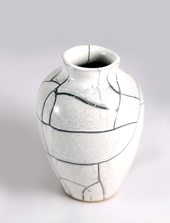 old items: Beautiful Old vase with cracks in studio shot