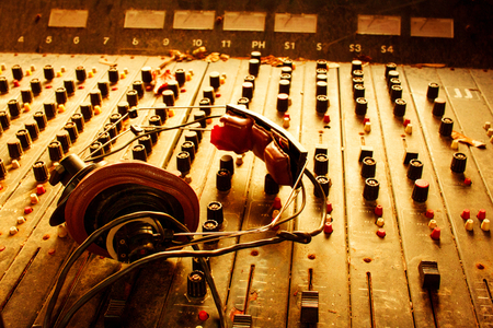 Old dusty retro vintage mixer and headphones in sepia Stock Photo