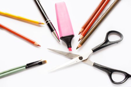 Lots of colorful pencils, purple felt tip pen marker, pen, scissors and brushes on white background
