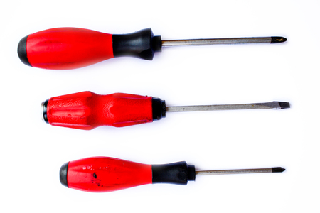Three Red screwdrivers isolated on white background