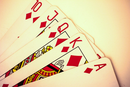 Playing cards close up detail. Black and red cards with a little bit sepia fiter