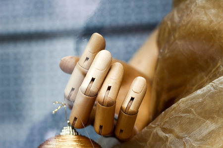 Close up of a hand of a big wooden man model for painting. Fingers Stock Photo