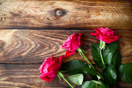 Bouquet of red roses on wooden background. Valentines Day background Stock Photo