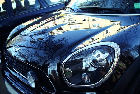 cooper: PRUSZKOW, POLAND, 26 March 2017: Black chrome mini car close up. Beautiful vehicle Editorial