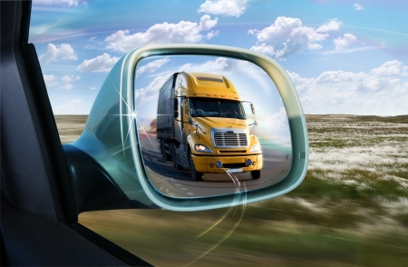 mirror: Truck in the rear-view mirror