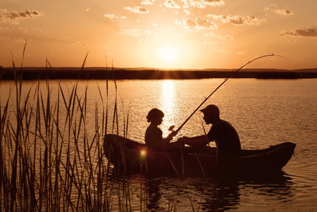 lake sunset: Fishing boat on the river at sunset