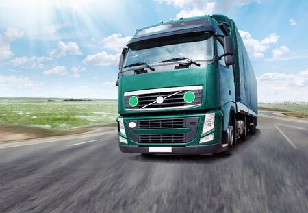 autobahn: Green truck. Truck Driving on the Autobahn
