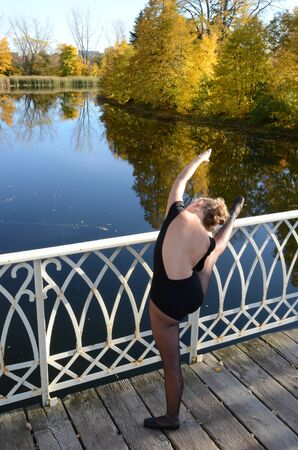 stretching by the water