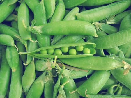 underlying: Pods of green peas