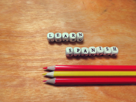 spanish language: Caption beads - Learn Spanish and colored pencils