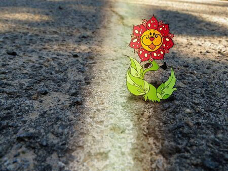 natural force: Combination of drawing and photography - fabulous flower on the asphalt Stock Photo