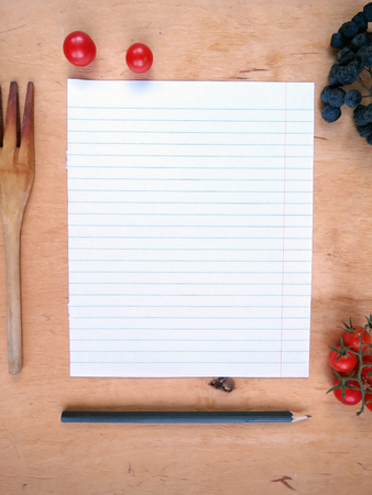 the recipe to write down: Piece of paper from a notebook for recipes Stock Photo