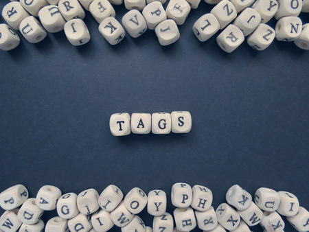jumbled: Word Tags of small white cubes next to a bunch of other letters on the surface of the composition on a dark background