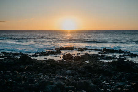 Beautiful sunset over the ocean and rocky coast. Tenerife Stock Photo