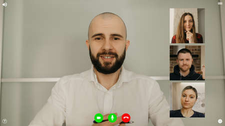 A desktop computer screen view of the telecommunications application during a video conference on which the team lead is asking about achievements. A multi-ethnic business team in an online meeting.