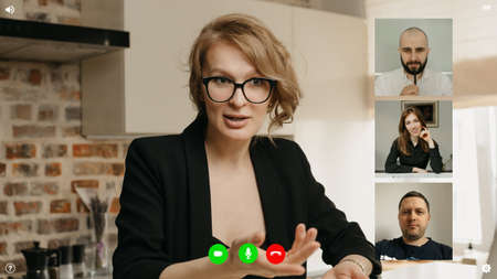 A desktop computer screen view of the telecommunications application during a video conference on which the specialist is reporting about achievements. Multi-ethnic business team in an online meeting.