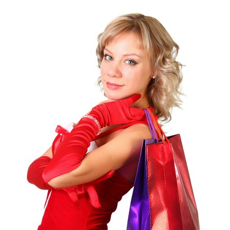 Girl in santa dress with bags doing shopping photo