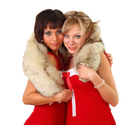 Two beautiful women in christmas dress with fur photo