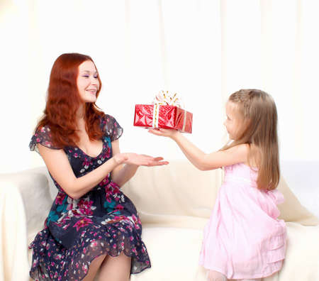 Girl gives present to mother photo