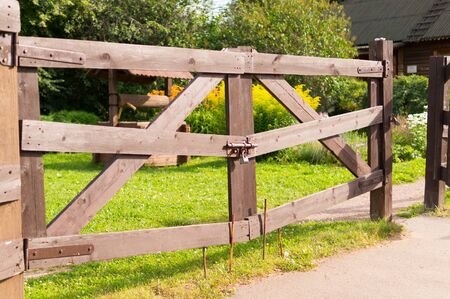 brown wooden gates in summer village. background, travel