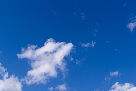Bright blue sky with clouds and sun. Stock Photo