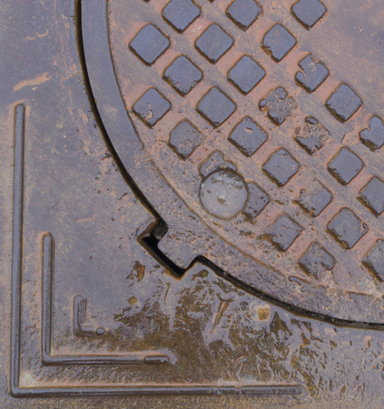 wet rusty sewer hatch. background, texture Stock Photo