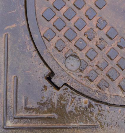 wet rusty sewer hatch. background, texture Reklamní fotografie